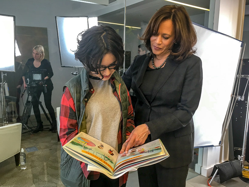 Kamala Harris reading Superheroes are Everywhere to Sasha Matthews